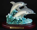 Trio Surfing Dolphins Sculpture